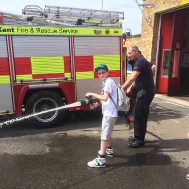 Jamie having a go at the fire brigade hoses.
