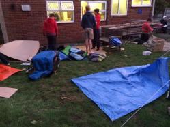 Dismantling the cardboard shelters
