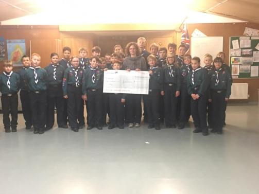 Handing over the cheque of £810 to Pr