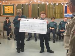 Aidan & Charlie handing over the cheque