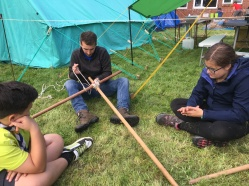 Slug showing the Scouts how to tie lashings!