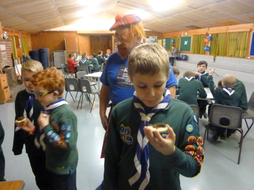 Our Cubs eating haggis and oatcakes