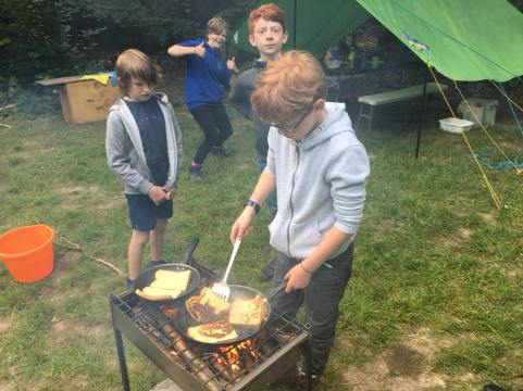 Our Scouts cooking breakfast