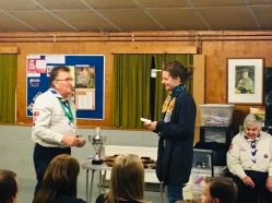 Chief presenting cheque to Porchlight representative
